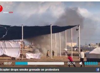 """Gaza 14 maj 2014. Røgbombe falder fra """"quadcopter"""" drone."""